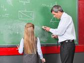 Professor Teaching Mathematics To Little Girl On Board — Stock Photo