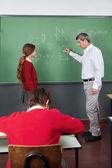 Male Teacher Teaching Geometry To Girl In Classroom — Stock Photo