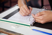 Schoolboy Copying At Desk During Examination — Stock Photo