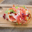 Delicious Parma Ham Sandwich On Wooden Plate — Stock Photo #27432287