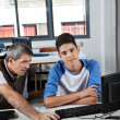 Teenage Schoolboy With Teacher Using Computer In Lab — Stock Photo