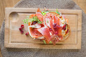 Delicious Parma Ham Sandwich On Wooden Plate — Stock Photo