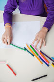 Girl With Color Pencils And Paper At Desk — Stok fotoğraf