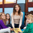 Teacher And Children With Book In Classroom — Stock Photo