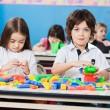 Boy With Female Friend Playing Blocks In Kindergarten — Stock Photo