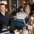 Stock Photo: Male Bartender With Colleague Working In Background
