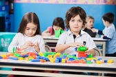 Boy With Female Friend Playing Blocks In Kindergarten — Stock Photo