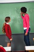 Female Teacher Teaching Mathematics To Teenage Schoolgirl — Stock Photo
