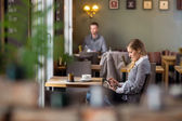 Pregnant Woman Using Digital Tablet At Cafe — Stock Photo