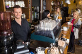 Male Bartender With Colleague Working In Background — Stock Photo