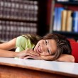 Happy Schoolgirl Looking Away While Leaning On Table — Stock Photo