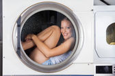Mischievous Woman Sitting Inside Washing Machine — Stock Photo