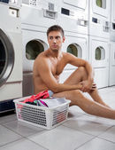 Bored Man With Laundry Basket Waiting To Wash Clothes — Stock Photo