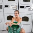 WomWith Clothes Basket In Laundromat — Stock Photo #27600089