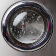 Stock Photo: Washing Machine With Foam On Front Load