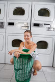 Woman With Clothes Basket In Laundromat — Stock Photo