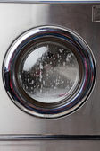 Washing Machine With Foam On Front Load — Stockfoto