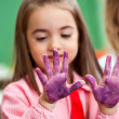 Girl Looking At Colored Hands In Art Class — Stock Photo