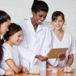Teacher With Teenage Girls Using Digital Tablet At Desk — Stock Photo