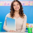 Teacher Holding Book While Sitting At Desk — Stock Photo