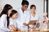 Teacher With Teenage Girls Using Digital Tablet At Desk — Stock Photo