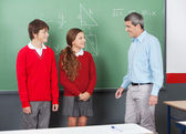 Teacher And Teenage Students Looking At Each Other — Stock Photo