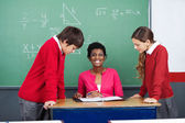 Teacher With Students At Desk — Stock Photo