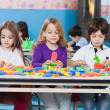 Children Playing With Construction Blocks In Classroom — Stock Photo
