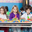 Stock Photo: Children Playing With Construction Blocks In Classroom