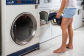 Man Putting Clothes In Washing Machine — Stock Photo