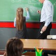 Girl Drawing Geometric Shapes On Board In Classroom — Stock Photo