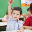 Stock Photo: Boy Showing Clay Model In Preschool