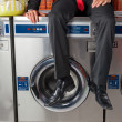 Businessman Sitting On Washing Machine — Stock Photo