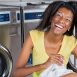 Cheerful Woman With Clothes In Laundry — Stock Photo