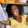 Woman Carrying Basket Of Clothes In Laundromat — Stock Photo