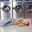 Woman Listening Music While Resting In Laundry — Stockfoto
