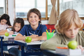 Schoolboy Sitting At Desk With Classmates In A Row — Stock Photo