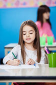 Girl Drawing With Sketch Pen In Preschool — Foto Stock