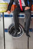 Businessman Sitting On Washing Machine — Stock Photo