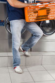 Man Holding Basket Of Clothes In Laundry — Stock Photo