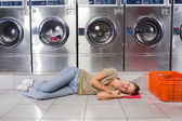 Woman Listening Music While Resting In Laundry — Stock Photo