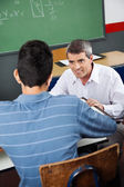 Professor Looking At Male High School Student — Stock Photo