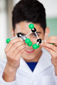 Teenage Schoolboy Analyzing Molecular Structure — Stock Photo