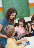 Teacher And Children Playing With Xylophone In Class — Stock Photo