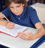 Schoolboy Cheating During Examination — Stock Photo