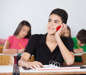 Male Student Using Cellphone In Classroom — Stock Photo