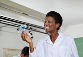 Teacher Smiling While Looking At Molecular Structure — Stockfoto