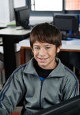 Happy Schoolboy Sitting In Computer Class — Stock Photo