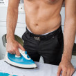 Shirtless Man Ironing Shirt On Table — Stock Photo