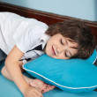 Stock Photo: Boy Lying On Heartshaped Pillow In Kindergarten